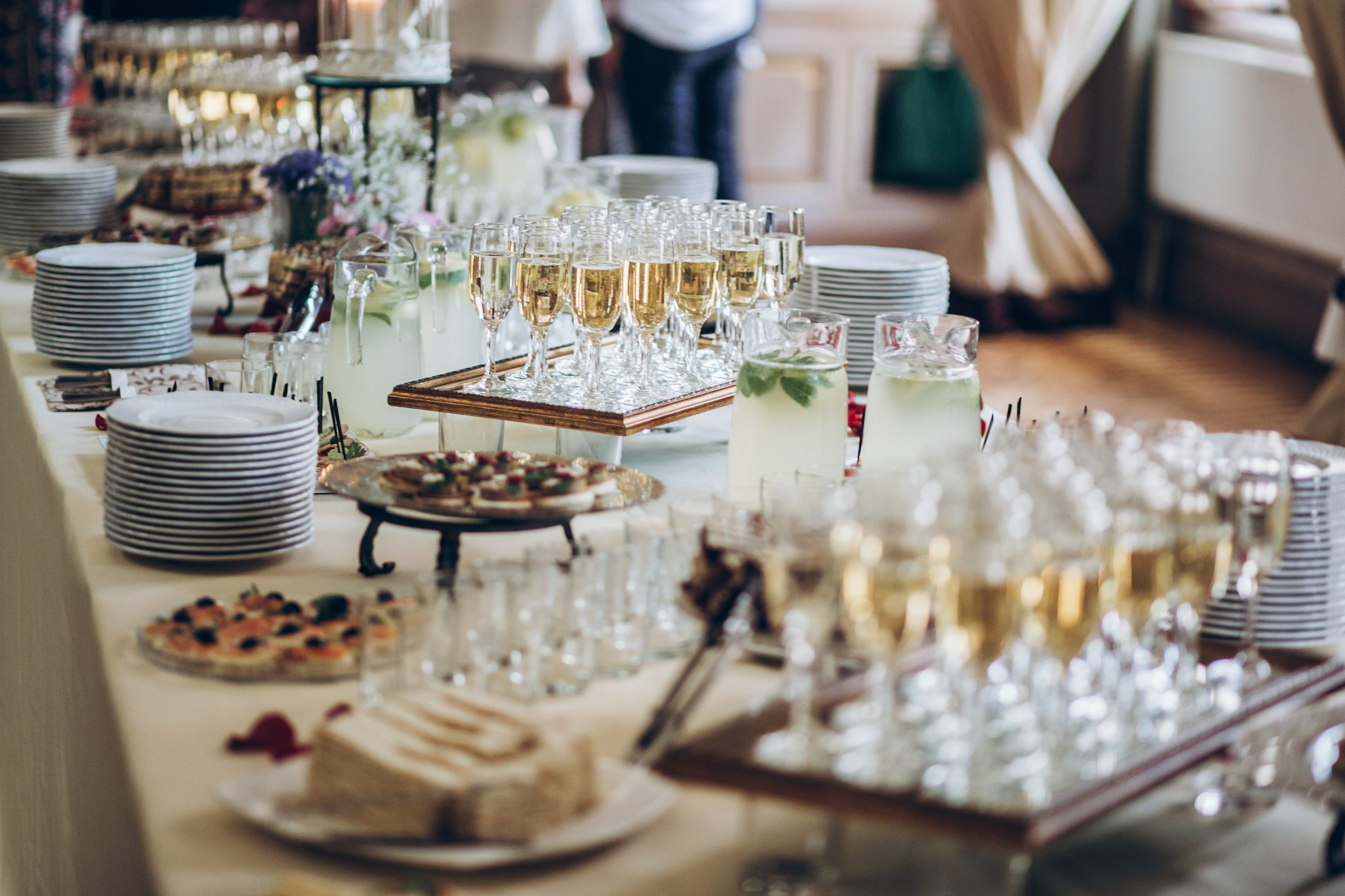 Stylish champagne glasses and food  appetizers on table at weddi